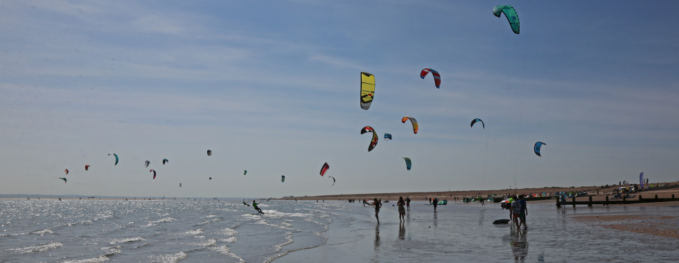 Kites flying on the beach on a beautiful day